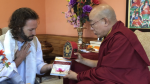 Dr Clint and Oracle of HH Dalia Lama, blessing the book