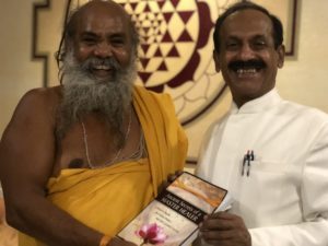 Dr Naram and Swami Omkar With a Book Blessed by Many Great Saints and Sages